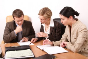 business meeting  - 2 woman, 1 man